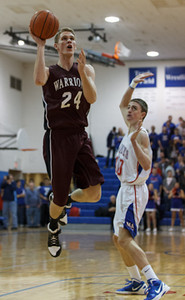 Wheaton Warriors Gordon Behr drives to the basket against Marmion at Marmion in Aurora, IL on Friday, December 14, 2012 (Sean King for The Kane County Chronicle)