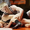 Rob Winner – rwinner@shawmedia.com<br /> <br /> Kaneland's Stephen Gust (top) controls DeKalb's Brendan McGee during their 113-pound match in DeKalb, Ill., Thursday, Dec. 6, 2012. DeKalb defeated Kaneland, 50-23.