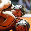 Rob Winner – rwinner@shawmedia.com<br /> <br /> DeKalb's Doug Johnson (top) controls Kaneland's Esai Ponce during their 132-pound match in DeKalb, Ill., Thursday, Dec. 6, 2012. DeKalb defeated Kaneland, 50-23.