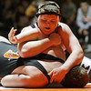 Rob Winner – rwinner@shawmedia.com<br /> <br /> Kaneland's Justin Diddell (top) controls DeKalb's Wes Leffelman during their 285-pound match in DeKalb, Ill., Thursday, Dec. 6, 2012. DeKalb defeated Kaneland, 50-23.