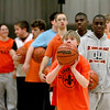 Mack Schweizer shoots the ball during practice with the St. Charles East Fighting Saints Special Olympics basketball team.
