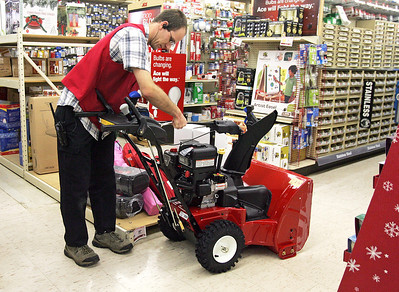 H. Rick Bamman - hbamman@shawmedia.com Sales associate Keith Brandmire (cq) assembles a Toro Power Max snow blower Thursday at the Ziekler's Ace Hardware store in Huntley. Brandmire said they had received a few calls from customers checking on the supply of snow shovels.
