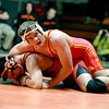 Batavia's Mickey Watson (top) competes against Keegan Furmanski of St. Charles East in the 160-pound weight class during their dual meet at East Thursday night.