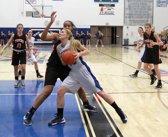 St. Charles North freshman Morgan Rosencrants drives towards the basket in their game against Wheaton Warrenville South on Tuesday, Dec. 18.<br /> Sarah Minor — sminor@shawmedia.com