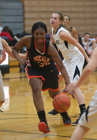 Jade Barber of DeKalb rushes to score a basket during the Kaneland vs. DeKalb girls basketball game at Kaneland High School Tuesday, Dec. 18.