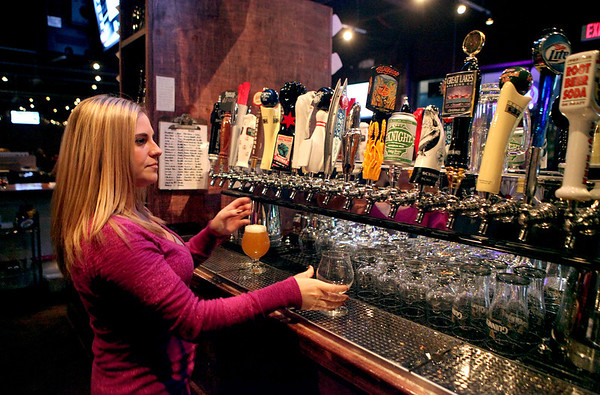 Robin Tabbert, manager of the Tap House Grill in St. Charles, pours one of 40 beers the restaurant has on draft.