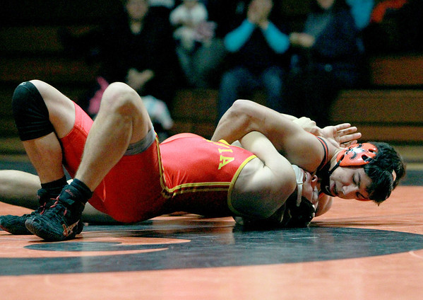 St. Charles East's Ramon Lopez (top) competes against Trevor Kilgallen of Batavia in the 152-pound weight class during their dual meet at East Thursday night.