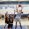Nicole Davidson of St. Charles North goes up for a shot in their game against Wheaton Warrenville South on Tuesday, Dec. 18.<br /> Sarah Minor — sminor@shawmedia.com