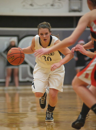 Kaneland's Allyson O' Herron forces her way past DeKalb at Kaneland High School Tuesday, Dec. 18.