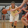 Kaneland's Allyson O' Herron forces her way past DeKalb at Kaneland High School Tuesday, Dec. 18.