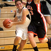 Brooke Harner of Kaneland pushes past Madelyne Johnson of DeKalb during the Kaneland vs. DeKalb girls basketball game at Kaneland High School