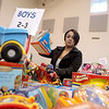 Dalmarie Arroyo of Batavia chooses toys for her two sons during the Toy Shop distribution day at the Salvation Army's Joe K. Anderson Community Center in St. Charles Wednesday morning.