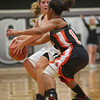 Sarah Grams of Kaneland defends the ball from Brittney Patrick of DeKalb during the Kaneland vs. DeKalb girls basketball game at Kaneland High School Tuesday, Dec. 18.