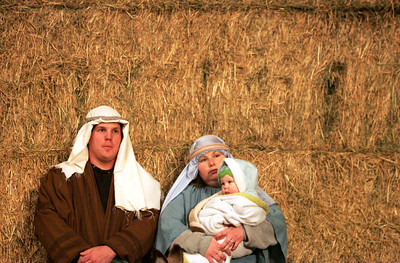 Monica Maschak - mmaschak@shawmedia.com Cody Purdom (left) and Valerie Purdom reinact the roles Joseph and Mother Mary with their daughter Mollie Purdom as baby Jesus at the Marengo United Methodist Church annual Live Nativity service held at Cody's Farm on Christmas Eve.