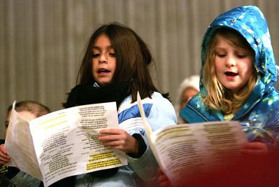 Monica Maschak - mmaschak@shawmedia.com Kiersten Fischer (left) and Summer Kunzer, with the Marengo United Methodist Church Girls' Ensemble, sing carols with church and community members at the annual Live Nativity service at Cody's Farm.