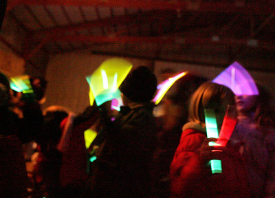 Monica Maschak - mmaschak@shawmedia.com Children from the audience wave glow sticks to participate in the lighting the barn during the singing of a carol at the Marengo United Methodist Church annual Live Nativity service.