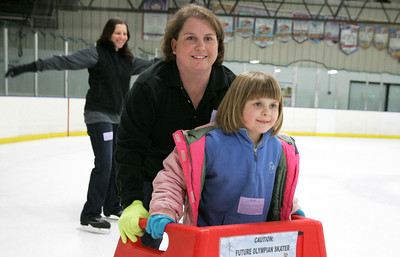 Monica Maschak - mmaschak@shawmedia.com Six-year-old Abby Quast ice skates for the first time with her mother Vickie Quast at the Crystal Ice House in Crystal Lake on Wednesday, December 26, 2012. The Quasts were visiting the area for the holidays from Minooka.