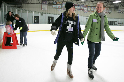 Monica Maschak - mmaschak@shawmedia.com Sisters Kylie Challender (left), 15, and Christyn Challender, 23, skate and spend time together during a public skate session a the Crystal Ice House the day after Christmas.  Christyn Challender came from Georgia to spend the holiday with her family in Lake in the Hills.