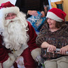 Jeanette A. smiles with Santa Claus at Marklund at Mill Creek in Geneva Monday, Dec. 24. Clients of Marklund opened presents with family and volunteers Christmas Eve morning.