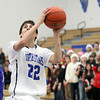 Jeff Krage – For the Kane County Chronicle<br /> St. Charles North's Kyle Swanson drives around Geneva's Connor Chapman during Friday's game in St. Charles.<br /> St. Charles 12/21/12