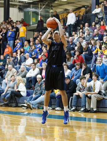 St. Francis' Andrew Kimball (1) shoots a three point shot against Aurora Central at Aurora Central in Aurora, IL on Saturday, December 22, 2012 (Sean King for The Kane County Chronicle)