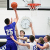 Jeff Krage – For the Kane County Chronicle<br /> Geneva's Nate Navigato takes a shot over St. Charles North's Jake Ludwig during Friday's game in St. Charles.<br /> St. Charles 12/21/12