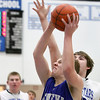Jeff Krage – For the Kane County Chronicle<br /> Geneva's Jason D'Amico goes up for a shot while being defended by St. Charles North's Jack Callaghan during Friday's game at St. Charles North.<br /> St. Charles 12/21/12