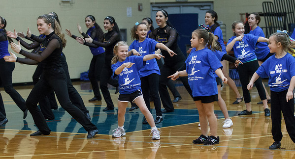 Young students from the ACC Dance Team Clinic performed with the dance team during half time at Aurora Central in Aurora, IL on Saturday, December 22, 2012 (Sean King for The Kane County Chronicle)