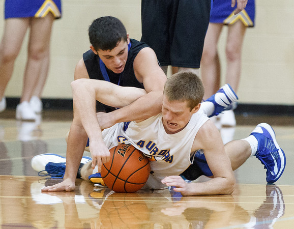 St. Francis' Jason Sullivan (left) and Aurora Central's Mike O'Donnell fight for a loose ball during the 4th quarter at Aurora Central in Aurora, IL on Saturday, December 22, 2012 (Sean King for The Kane County Chronicle)