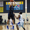 St. Francis' Zach Prociuk (left) shoots a jump shot over Aurora Central's Anthony Andujar at Aurora Central in Aurora, IL on Saturday, December 22, 2012 (Sean King for The Kane County Chronicle)