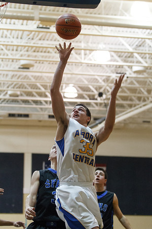 Aurora Central's Phil Schuetz (35) grabs an offensive rebound and puts the ball back in the hoop against St. Francis during a 4th quarter rally at Aurora Central in Aurora, IL on Saturday, December 22, 2012 (Sean King for The Kane County Chronicle)