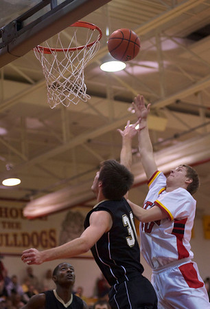 Mike Carlson of Batavia scores a point against Streamwood at Batavia High School Friday, Dec. 21.