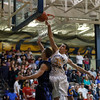 Aurora Central's Sean Harreld (right) rejects a layup from St. Francis' Kevin McShea at Aurora Central in Aurora, IL on Saturday, December 22, 2012 (Sean King for The Kane County Chronicle)