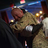 U.S Army Reserve Cpt. Robert J. Mikyska hugs his colleague from the 416th Theater Engineering Command unit David O' Lery during his welcome home party at the Turf Room in North Aurora Saturday, Dec. 22. Mikyska was in Afghanistan since March as an Engineer Officer. He was awarded the Joint Service Commendation Medal for his service in combat zone.