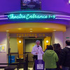 Ken Merrill collects tickets at Cinema 18 in Charlestown Mall on Christmas Day.