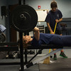 Firefighter Kellie Walsh works out with Lieutenant Kristen Wade, right, at the Sugar Grove Fire Department on Christmas Day. The staff is allowed more down time on holidays between calls and assignments. They would usually be given tasks between 9 a.m. and 5 p.m.