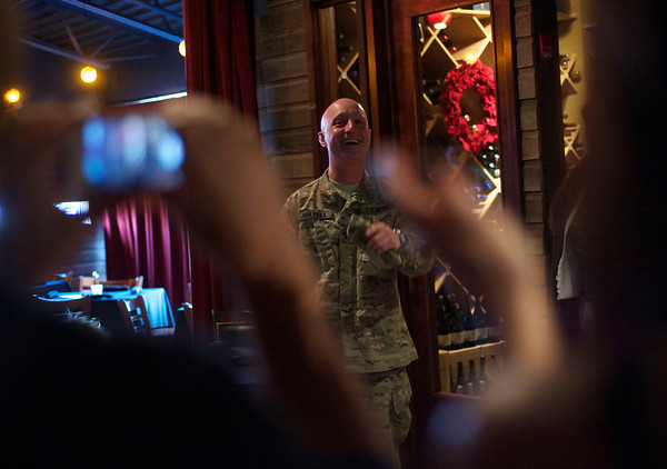 U.S Army Reserve Cpt. Robert J. Mikyska reacts at his surprise welcome home party at the Turf Room in North Aurora Saturday, Dec. 22. Mikyska was in Afghanistan since March as an Engineer Officer. He was awarded the Joint Service Commendation Medal for his service in combat zone.