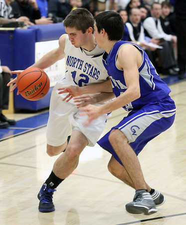 Jeff Krage – For the Kane County Chronicle<br /> St. Charles North's Quinten Payne is closely guarded by Geneva's Pat McCaffrey during Friday's game in St. Charles.<br /> St. Charles 12/21/12