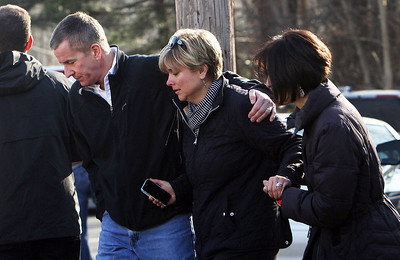 Teachers walk away from the Sandy Hook School following a shooting  at the school, Friday, Dec. 14, 2012 in Newtown, Conn. A man opened fire inside the Connecticut elementary school where his mother worked Friday, killing 26 people, including 18 children, and forcing students to cower in classrooms and then flee with the help of teachers and police. (AP Photo/The Journal News, Frank Becerra Jr.) ***MANDATORY CREDIT***