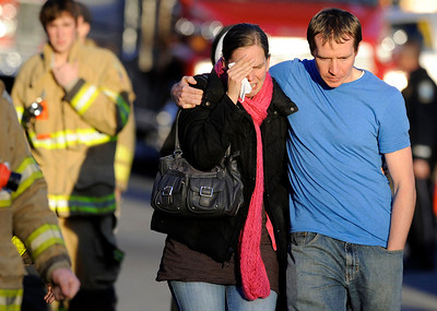 Victim's family leave a firehouse staging area following a shooting at the Sandy Hook Elementary School in Newtown, Conn., about 60 miles  northeast of New York City.  (AP Photo/Jessica Hill)