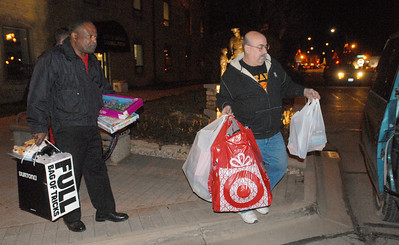 On Tuesday, Dec. 4, 2012, Roy Bailey (left) and Rudy Dubis, both of Batavia, who are members of the Batavia Access Committee, load toys into a van outside Batavia City Hall. The toys were donated at the previous night's city council meeting. The committee is in desperate need of toys, especially for older kids, to donate to Batavia families in need. Staff photo by Bill Ackerman