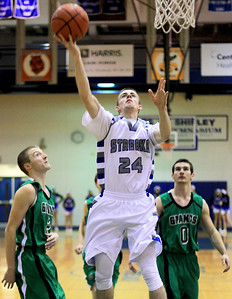 Sarah Nader - snader@shawmedia.com Woodstock's Jordan Turner (center) makes a shot during the first quarter of Monday's game against Alden-Hebron at Woodstock High School on December 17, 2012. Woodstock won, 63-48.