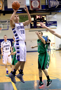 Sarah Nader - snader@shawmedia.com Woodstock's Mason Sutter makes a shot during the first quarter of Monday's game against Alden-Hebron at Woodstock High School on December 17, 2012. Woodstock won, 63-48.