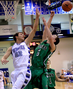 Sarah Nader - snader@shawmedia.com Woodstock's JerPatrick (left) and Alden-Hebron's Ian Johnson jump for the rebound during Monday's game at Woodstock High School on December 17, 2012.
