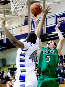 Sarah Nader - snader@shawmedia.com Woodstock's Damian Stoneking (left) blocks a shot by Alden-Hebron's Ian Johnson during the second quarter of Monday's game at Woodstock High School on December 17, 2012. Woodstock won, 63-48.