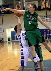 Sarah Nader - snader@shawmedia.com Alden-Hebron's Ian Johnson blocks a shot from a Woodstock player during the third quarter of Monday's game at Woodstock High School on December 17, 2012. Woodstock won, 63-48.