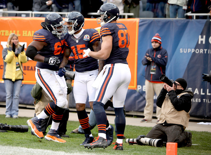 Chicago Bears wide receiver Brandon Marshall (15) is congratulated by teammates Chris Spencer (left) and Kellen Davis (right) after Marshall's touchdown in the first half of their 21-13 loss to the Green Bay Packers at Soldier Field Sunday.(Sandy Bressner photo)