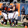 Chicago Bears wide receiver Brandon Marshall (15) is congratulated by teammates Chris Spencer (left) and Kellen Davis (right) after Marshall's touchdown in the first half of their 21-13 loss to the Green Bay Packers at Soldier Field Sunday.
