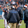 Chicago Bears quarterback Jay Cutler talks to Head Coach Lovie Smith and Offensive Coordinator Mike Tice during the fourth quarter of their their 21-13 loss to the Green Bay Packers at Soldier Field Sunday.