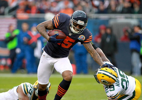 Chicago Bears wide receiver Brandon Marshall runs the ball into the end zone for a touchdown in the first half of their 21-13 loss to the Green Bay Packers at Soldier Field Sunday.